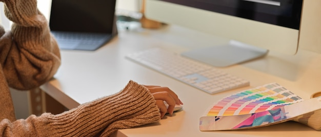 Woman in sweater using a computer