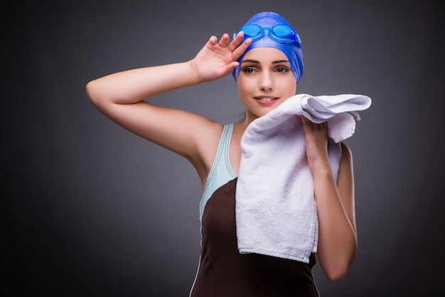 Woman swimmer against grey background