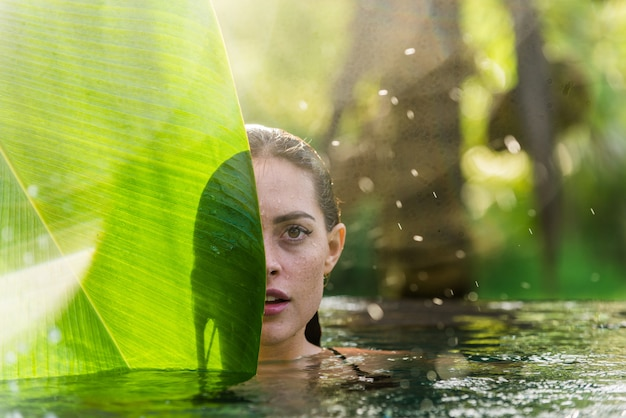 Woman in a swimming pool in bali