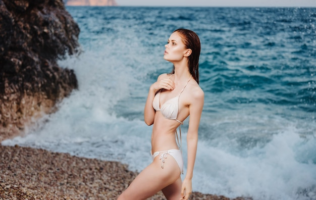 Woman in swimsuit on the beach tropics luxury summer vacation. high quality photo