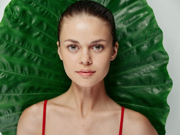 Woman in a swimsuit green leaf exotic attractive look closeup
