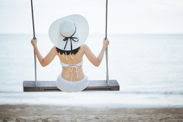 Woman on swing in beach