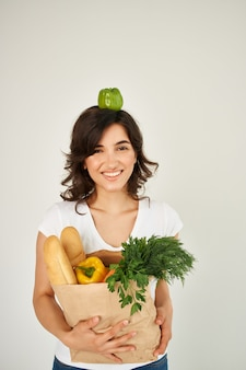 Woman for t-shirt food package healthy food delivery. high quality photo