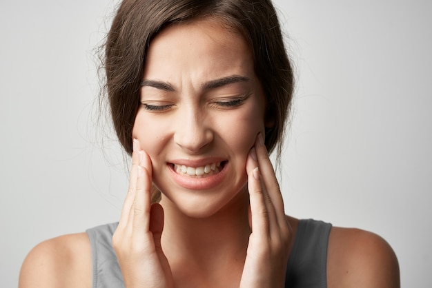 Woman in t shirt health problems migraine pain close-up. high quality photo