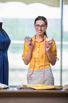 Woman tailor working on new clothing