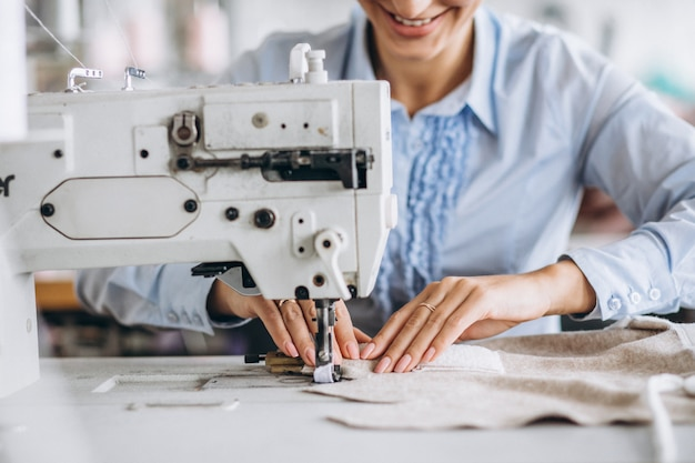 Woman tailor working at the sewing factory