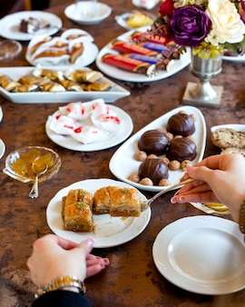 Woman takes baklava from the plate