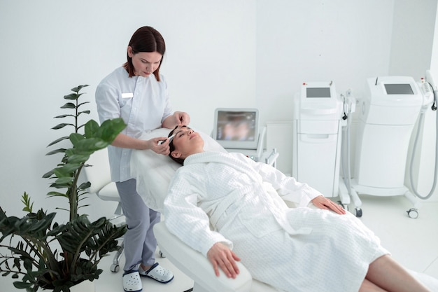 Woman takes care about her skin and doing cosmetology and lazer procedures
