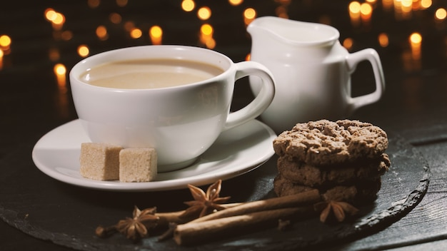Woman takes a cup of coffee and drinks concept  christmas cafe spiced coffee