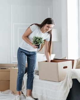 Woman takes things out of cardboard boxes