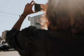 Woman taking a photo of the city