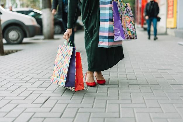 Woman taking bags on street
