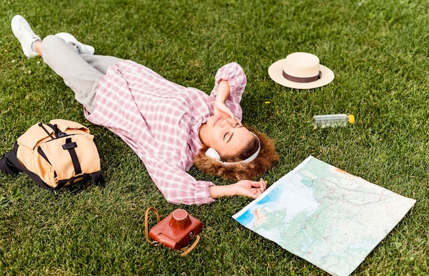 Woman taking a break after traveling outdoors