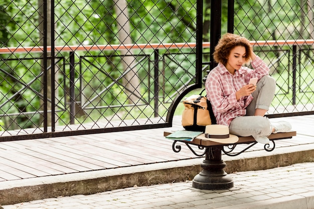 Woman taking a break from traveling with copy space