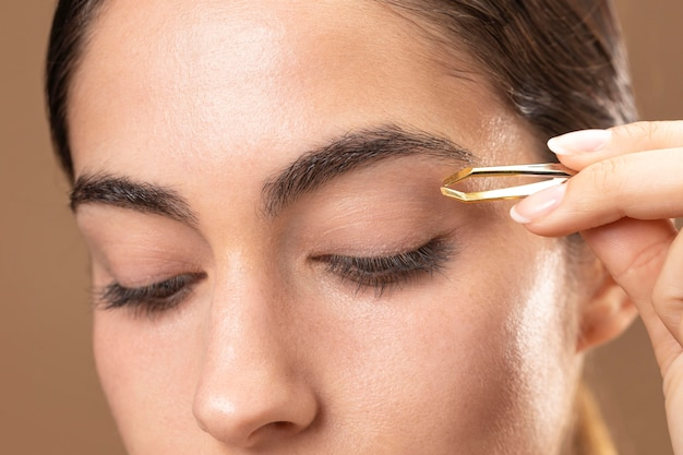 Woman taking care of her eyebrows