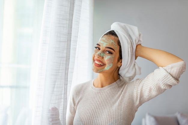 Woman taking care of her facial skin. beautiful woman applying mask to her face. beauty treatments.