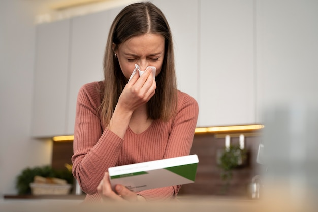 Woman taking a covid test alone at home