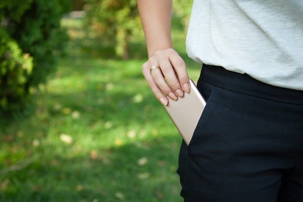 Woman taking her phone from her pocket