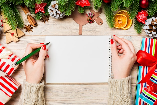 Woman taking notes on christmas table