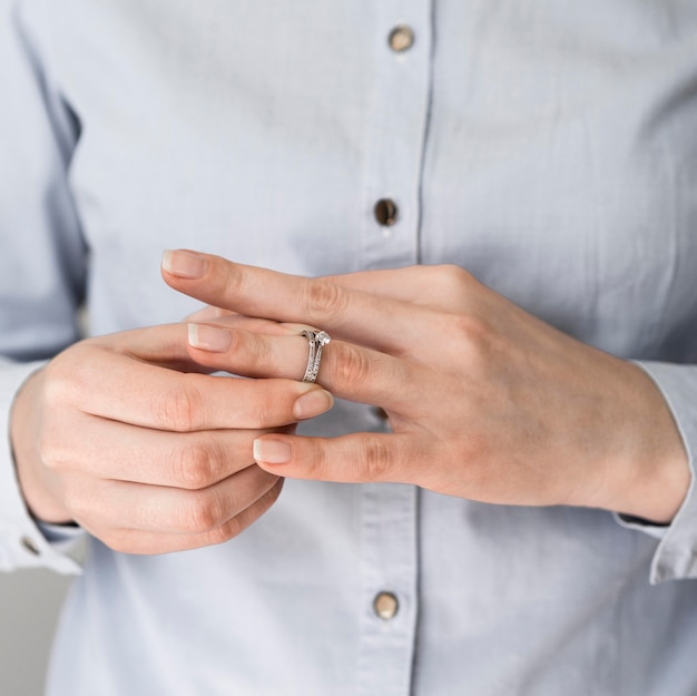 Woman taking off marriage ring