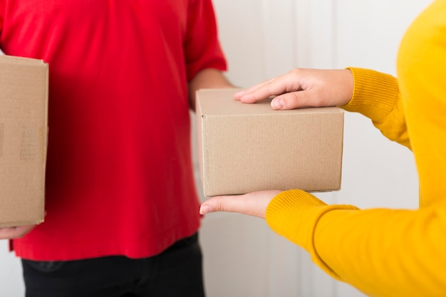 Woman taking a package from the delivery man