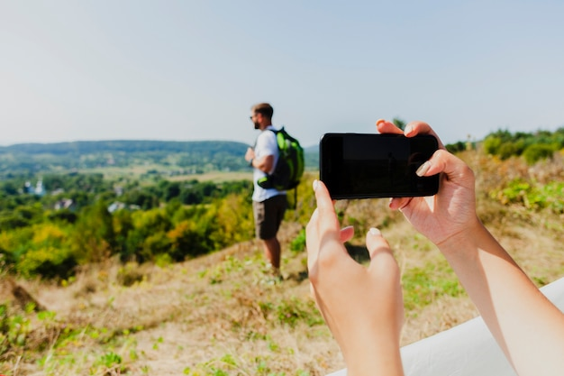 Woman taking a photo of his boyfriend
