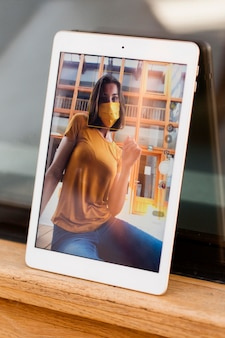 Woman taking photo with tablet