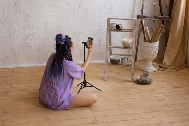 Woman taking photos for her business