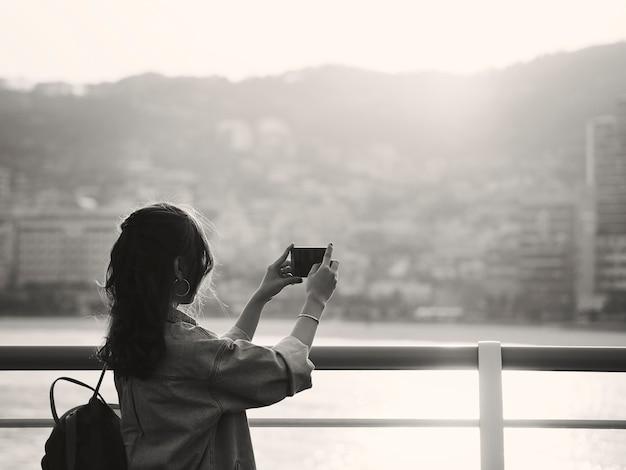 Woman taking scenic photo