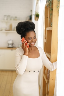 Woman talking on cellphone at home