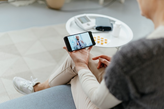 Woman talking to a doctor in a video chat