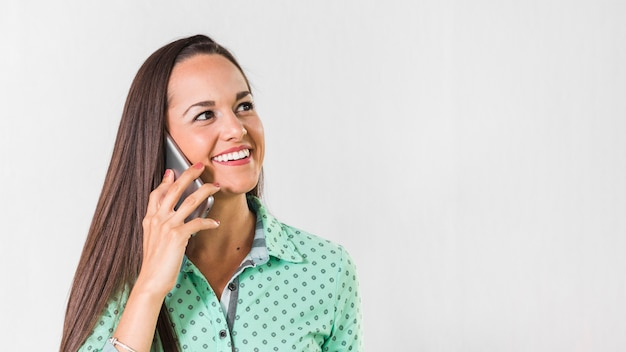 Woman talking at her phone with copy space