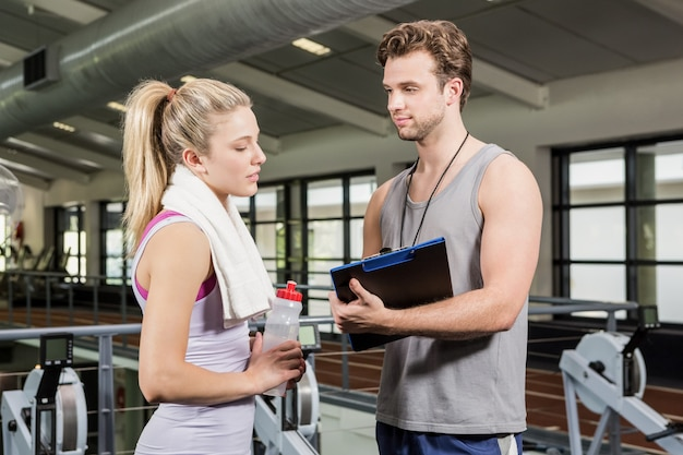 Woman talking to her trainer after a workout