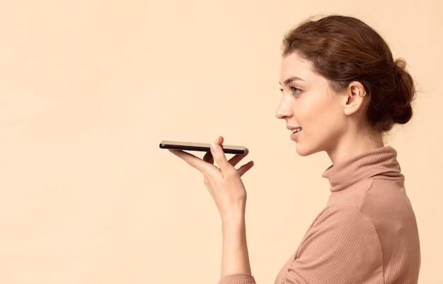 Woman talking on mobile phone speaker