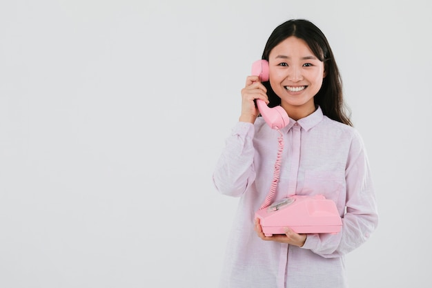 Woman talking on the telephone with copy space