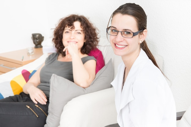 Woman talking to therapist on sofa