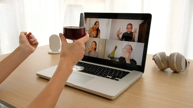 Woman talking on video chat with friends