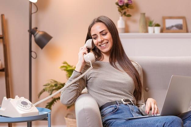 Woman talking at vintage telephone