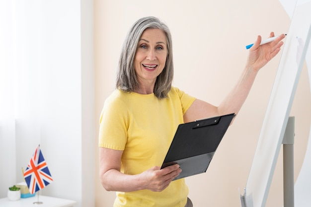 Woman teaching english lessons online at home
