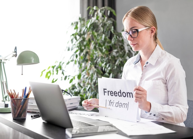 Woman teaching her students the definition of freedom