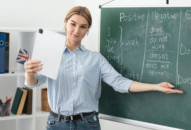 Woman teaching students in english class online