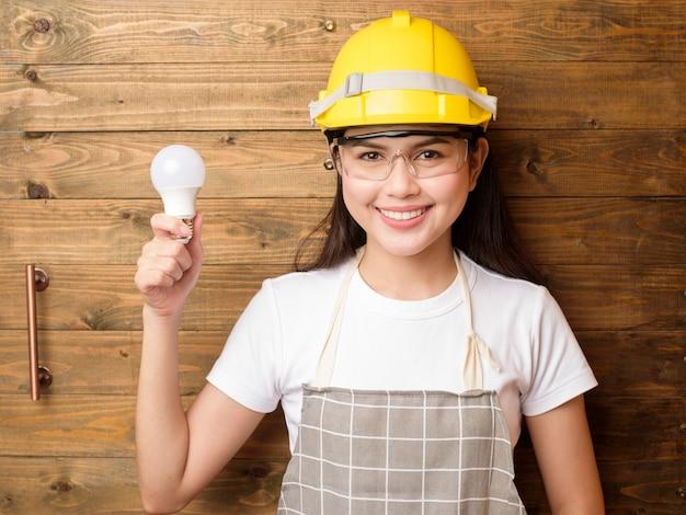 Woman technician portrait on wood background