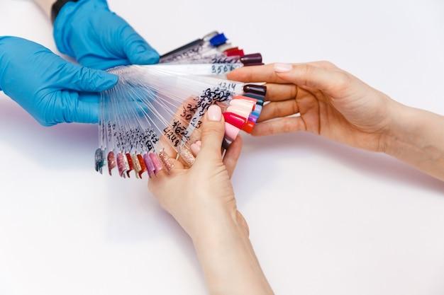 Woman testing nails in beauty salon