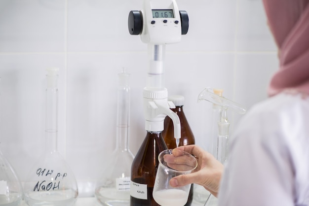 Woman testing samples of dairy products in the laboratory. test laboratory of a milk factory
