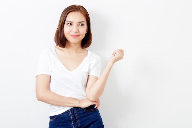 Woman thai in t-shirt and jeans wall