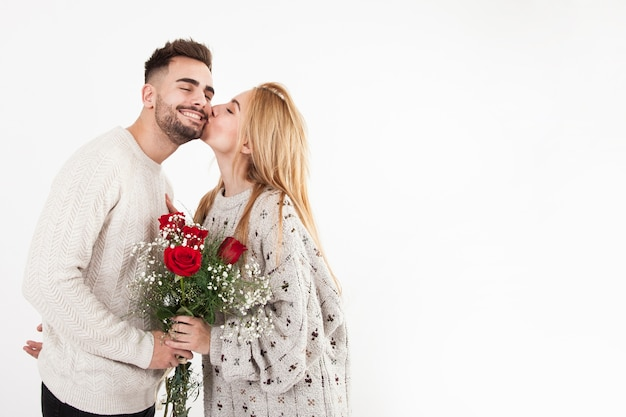 Woman thanking man for bouquet