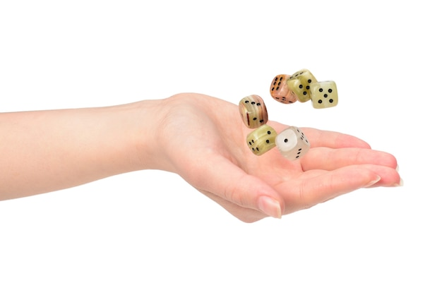 Woman throws dices isolated on white.