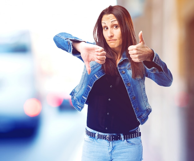 Woman thumbs up and down