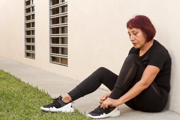 Woman ties the laces outdoors