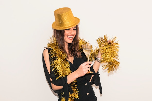 Woman in tinsel with champagne glass